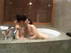 Japanese girls kiss and finger them hairy pussy