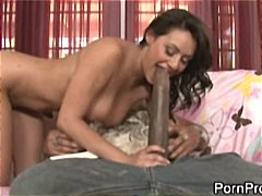 Brunette bitch shows her skill in tickling her tonsils with a monster big black dick