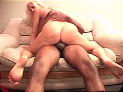 Busty blond occupied with black cock