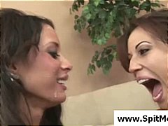 Two lesbians are playing with each other and spitting and licking
