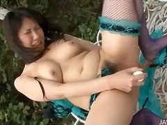 Outdoors in her fishnets and masturbating