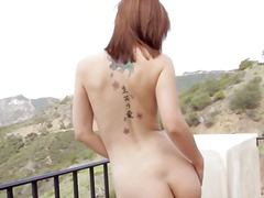 Redhead beauty masturbate outdoors