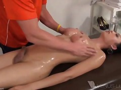 Oiled ladyboy drills a guy after massage