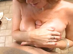 Darla crane is rubbing oil on her giant tits before she gives stud the best titty fuck of his life