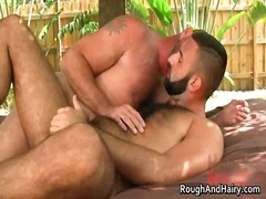 Two gay dudes have fun outdoor as they suck hard cock and fuck