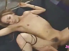 2 hot girls in sexy lingeries licking rubbing pussies in scissor on the bed in the basement