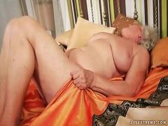 Busty grandma masturbating her hairy pussy